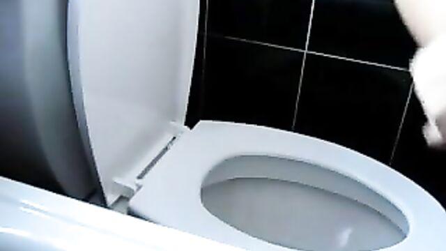 Girl pooping on toilet