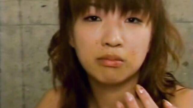cute japanese girl eating with pleasure